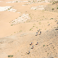 25 March 2007: Participants run over a small hill between Irhs and Khermou during the first stage of  the 22nd Marathon des Sables, a 6 days and 151 miles endurance race with food self sufficiency across the Sahara Desert in Morocco. Each participant must carry his, or her, own backpack containing food, sleeping gear and other material.