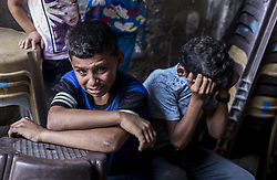 October 6, 2018 - Gaza City, The Gaza Strip, Palestine - Relatives of 12-year-old Palestinian boy, Fares Sersawi, who was killed by Israeli troops on Friday's protest at the Gaza Strip's border with Israel, mourn over his body at the family home during his funeral in Gaza City. (Credit Image: © Mahmoud Issa/SOPA Images via ZUMA Wire)