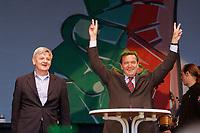 """15 SEP 2002, BERLIN/GERMANY:<br /> Joschka Fischer (L), B90/Gruene, Bundesaussenminister, und Gerhard Schroeder (R), SPD, Bundeskanzler, waehrend einer gemeinsamen Kundgebung unter dem Motto """"GO ON"""", Pariser Platz<br /> IMAGE: 20020915-01-020<br /> KEYWORDS: Gerhard Schröder, Koalition, rot, gruen, grün, rot-gruen, rot-grün"""