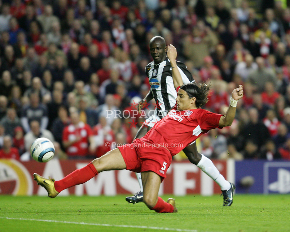 LIVERPOOL, ENGLAND - TUESDAY APRIL 5th 2005:  Liverpool's Milan Baros and Juventus' Lilian Thuram during the UEFA Champions League Quarter Final 1st Leg match at Anfield. (Pic by David Rawcliffe/Propaganda)