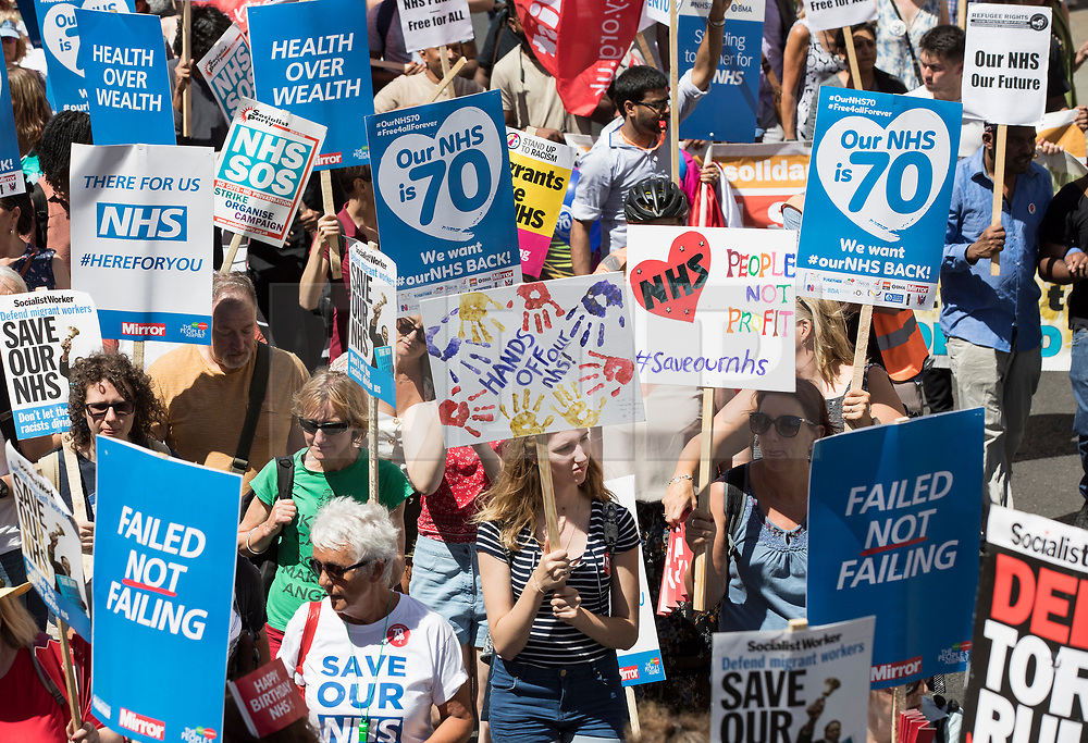 © Licensed to London News Pictures. 30/06/2018. London, UK. Protestors march along Haymarket in support of the National Health Service on the 70th anniversary of it's founding. Thousands are taking part and will hear speeches by Jeremy Corbyn and others in Whitehall. Photo credit: Peter Macdiarmid/LNP