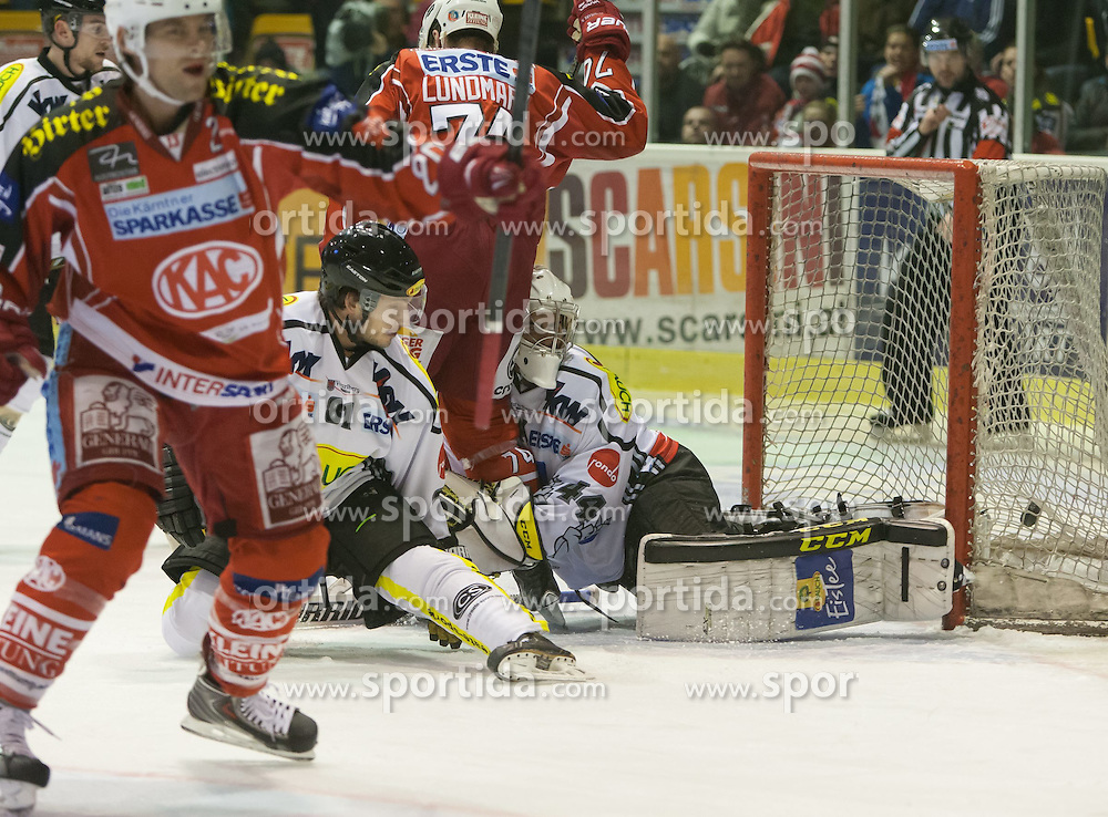 08.12.2013, Stadthalle, Klagenfurt, AUT, EBEL, KAC vs die Dornbirner, 49. Runde, im Tor zum 1: 0 für den KAC durch John Lammers (Kac, #20) Bild Jamie Lundmark (Kac, #74), Robert Lembacher (Dornbirner Bulldogs, #81), Adam Dennis (Dornbirner Bulldogs, #44), John Lammers (Kac, #20)// during the Erste Bank Icehockey League 49th Round match betweeen EC KAC and die Dornbirner at the City Hall, Klagenfurt, Austria on 2013/12/08. EXPA Pictures © 2013, PhotoCredit: EXPA/ Gert Steinthaler