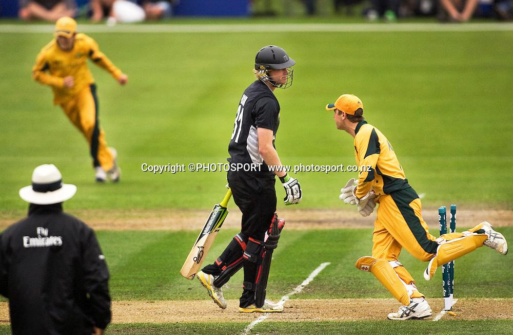 New Zealand batsman Harry Boam is bowled by Australian bowler Jason Floros, wicket keeper running in is Tom Triffitt. New Zealand v Australia, U19 Cricket World Cup Quarter Final, Mainpower Oval, Rangiora, Sunday 24 January 2010. Photo : Joseph Johnson/PHOTOSPORT