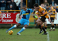 Photo: Ian Hebden.<br />Boston United v Wycombe Wanderers. Coca Cola League 2. 18/02/2006.<br />Wycombe's Jermaine Easter (L) gets a shot past Boston's Mark Greaves (L).