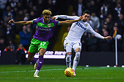 Pablo Hernandez of Leeds United (19) and Lloyd Kelly of Bristol City (17) tussle for the ball during the EFL Sky Bet Championship match between Leeds United and Bristol City at Elland Road, Leeds, England on 24 November 2018.