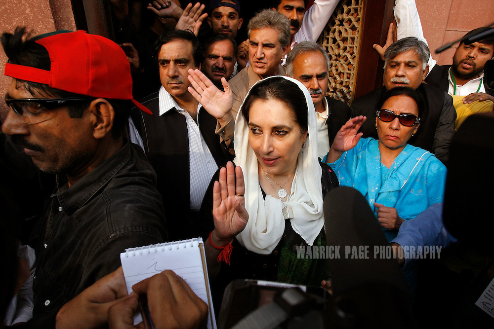 "LAHORE, PAKISTAN - NOVEMBER 12: Former Pakistani Prime Minister and head of Pakistan People's Party (PPP), Benazir Bhutto, speaks to media after praying at the tomb of Allama Iqbal on November 12, 2007 in Lahore, Pakistan. Bhutto announced that she has ended ""power-sharing"" talks with Pakistani President, Pervez Musharraf, citing the state of emergency making talks impossible. Bhutto has vowed to go ahead with her planned rally from Lahore to Islamabad tomorrow, urging thousands of PPP members to join her. (Photo by Warrick Page)"