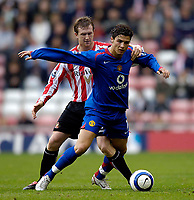 Photo: Jed Wee.<br />Sunderland v Manchester Utd. The Barclays Premiership. 15/10/2005.<br /><br />Manchester United's Cristiano Ronaldo (R) is tackled from behind by Sunderland's Steven Caldwell.
