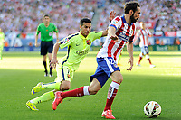 Atletico de Madrid´s Juanfran and FC Barcelona´s Pedro Rodriguez during 2014-15 La Liga match between Atletico de Madrid and FC Barcelona at Vicente Calderon stadium in Madrid, Spain. May 17, 2015. (ALTERPHOTOS/Luis Fernandez)