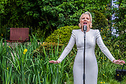 'The Savills and David Harber Garden', designed by celebrated designer Andrew Duff, with jazz singer Natalie Rushdie as the 'Lady of the Lake'  - Press preview day at The RHS Chelsea Flower Show.