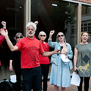 London. London School of Economics. Support from the Strawberry Thief Socialist choir for a lunchtime rally to support the strike by cleaners for better conditions....members of the UVW called a two day strike on June 1st and 2nd as part of their campaign for better rights and conditions for cleaners. The majority of the cleaners, who are employed by outsourced cleaning company Noonan, are from BME and Latin American origin and have been faced with far worse employment conditions than the mostly white staff employed directly by the LSE.