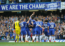 Chelsea's Didier Drogba is carried off by his team mates. - Photo mandatory by-line: Alex James/JMP - Mobile: 07966 386802 - 24/05/2015 - SPORT - Football - London - Stamford Bridge - Chelsea v Sunderland - Barclays Premier League