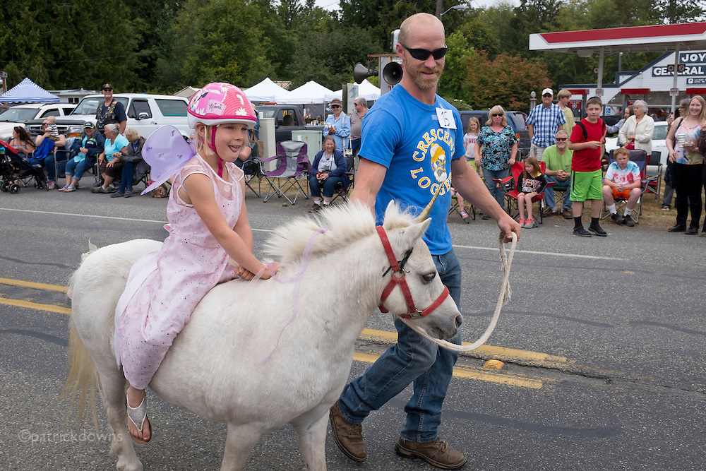 Fairy on a unicorn, at the Joyce Daze parade in Joyce WA, west of Port Angeles.