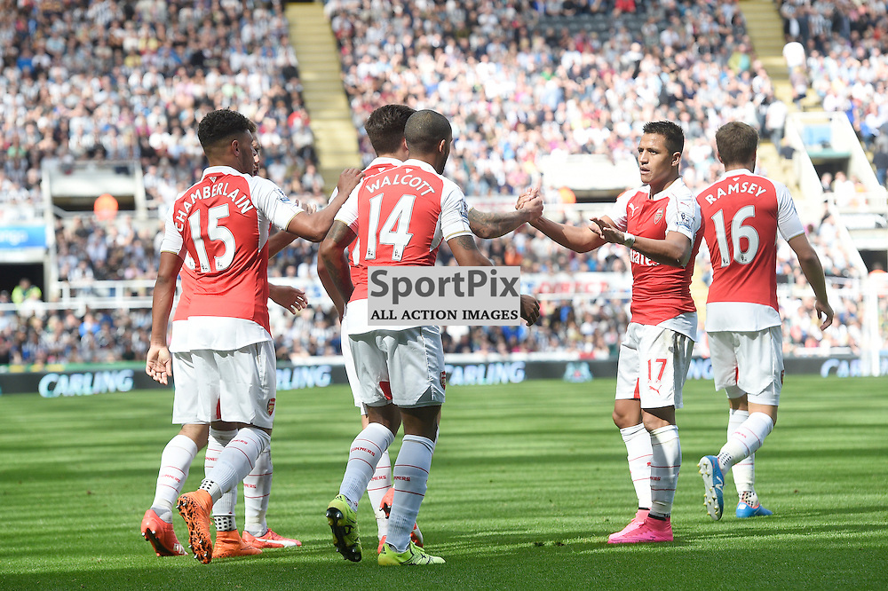 Arsenal team celebrate Alex Oxlade-Chamberlain's goal in the Newcastle United v Arsenal Barclays Premier League match at St James' Park Newcastle 09 August 2015<br /> <br /> (c) Greg Macvean / SportPix.org.uk