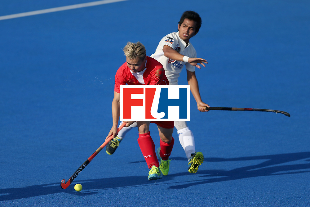 LONDON, ENGLAND - JUNE 20: Xiaoping Guo of China takes the ball past Fitri Saari of Malaysia during the Pool A match between China and Malaysia on day six of the Hero Hockey World League Semi-Final at Lee Valley Hockey and Tennis Centre on June 20, 2017 in London, England.  (Photo by Alex Morton/Getty Images)