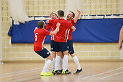 Michael Connor is mobbed by team mates after his second goal against TMT Futsal Club in the Scottish Futsal Cup Final at Perth College, Perth, Photo: David Young<br /> <br />  - © David Young - www.davidyoungphoto.co.uk - email: davidyoungphoto@gmail.com