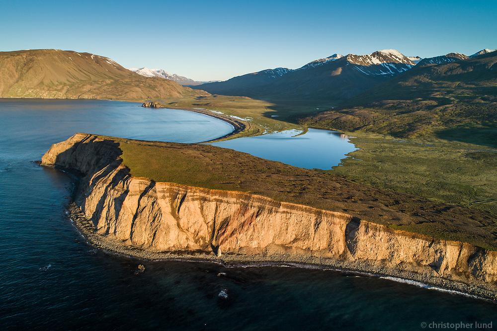 Víkurhöfði and Flateyjardalur at golden hour. Aerial Drone Shot. North Iceland.