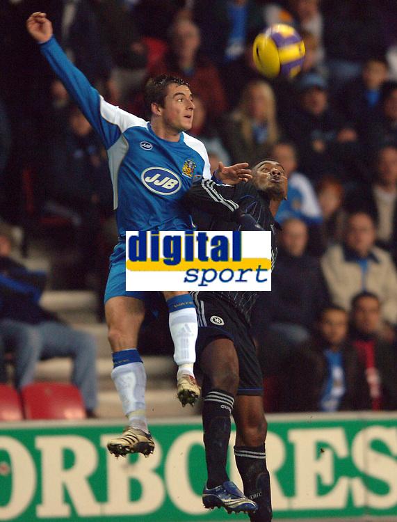 Photo: Paul Greenwood.<br />Wigan Athletic v Chelsea. The Barclays Premiership. 23/12/2006. Wigan's Leighton Baines, left, battles with Salomon Kalou