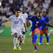 Yves Hadley Desmarets, Haiti, (right),  is challenged by Jorge Aaron Claros, Honduras, during the Haiti V Honduras CONCACAF Gold Cup group B football match at Red Bull Arena, Harrison, New Jersey. USA. 8th July 2013. Photo Tim Clayton