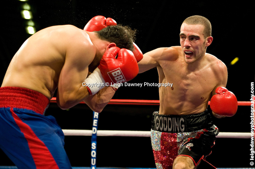 Rick Godding (black shorts) defeats Youssef Al Hamidi at the Bolton Arena, Bolton, UK on 23rd September 2009. Frank Maloney Promotions. photo credit © Leigh Dawney