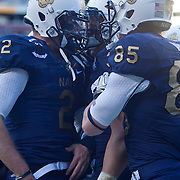 Navy fullback Alexander Teich #39 celebrates with his teammates Navy Quarterback Kriss Proctor #2 and Navy Wide receiver Matt Aiken #85 in the North end zone after rushes for 10 yards and the NAVY touchdown late in the second quarter Saturday, Dec. 10, 2011 at Fed EX field in Landover Md.<br /> <br /> Navy set the tone early in the game as Navy defeats Army 31-17 in front of 82,000 at Fed EX Field in Landover Md