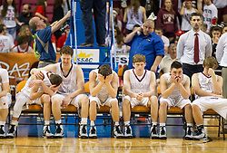 Wheeling Central players react to losing to Magnolia during the Class A championship game at the Charleston Civic Center.
