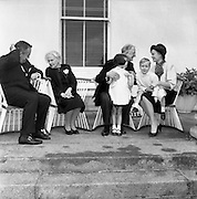 At Aras an Uachtarain, Sinead, Bean de Valera and President de Valera help Prince Rainier and Princess Grace with looking after Prince Albert and Princess Caroline. .15.06.1961