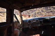 The interior of an abandoned car near a mine site in Death Valley National Park.
