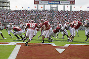 Alabama Crimson Tide quarterback Brodie Croyle hands the ball off to running back Tim Castille in the end zone during a 24 to13 Tide win over the Arkansas Razorbacks on September 24, 2005 at Bryant-Denny Stadium in Tuscaloosa, Alabama..Mandatory Credit: Wesley Hitt/Icon SMI
