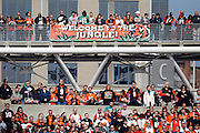 "Fans stand near the ""Welcome to the Jungle"" sign during the Cincinnati Bengals NFL week 8 football game against the Miami Dolphins on Sunday, October 31, 2010 in Cincinnati, Ohio. The Dolphins won the game 22-14. (©Paul Anthony Spinelli)"