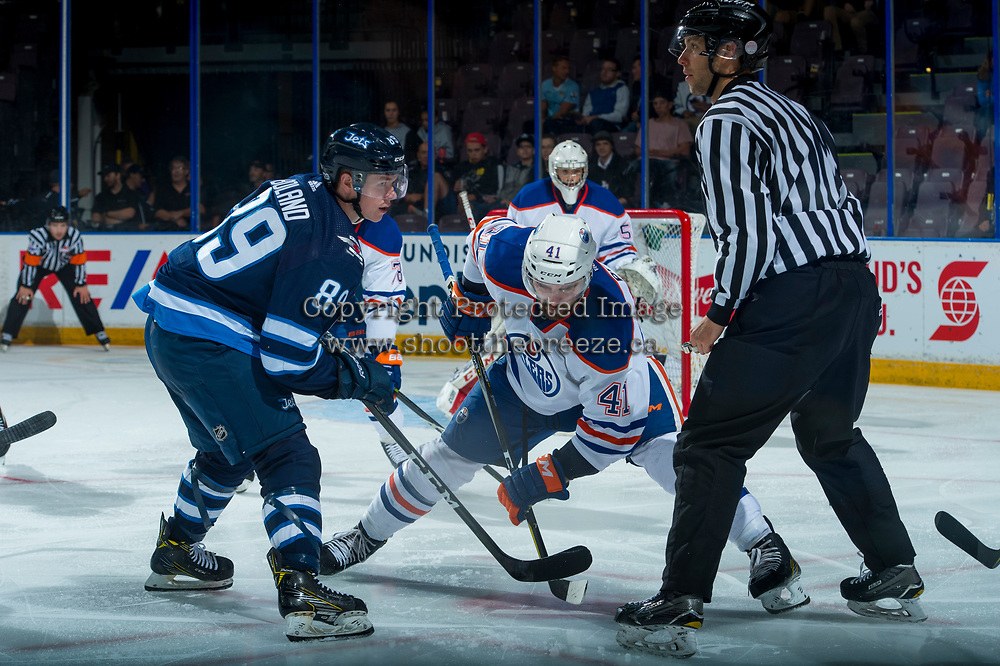 PENTICTON, CANADA - SEPTEMBER 9: Tyler Boland #89 of Winnipeg Jets faces off against Evan Polei #41 of Edmonton Oilers on September 9, 2017 at the South Okanagan Event Centre in Penticton, British Columbia, Canada.  (Photo by Marissa Baecker/Shoot the Breeze)  *** Local Caption ***