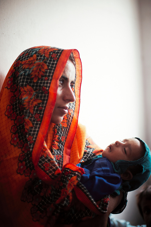 Fauzia Khan with her nephew Tagiya Barbar at the government health clinic in Mitho Barbar, Dadu, Sindh, Pakistan on July 4, 2011.