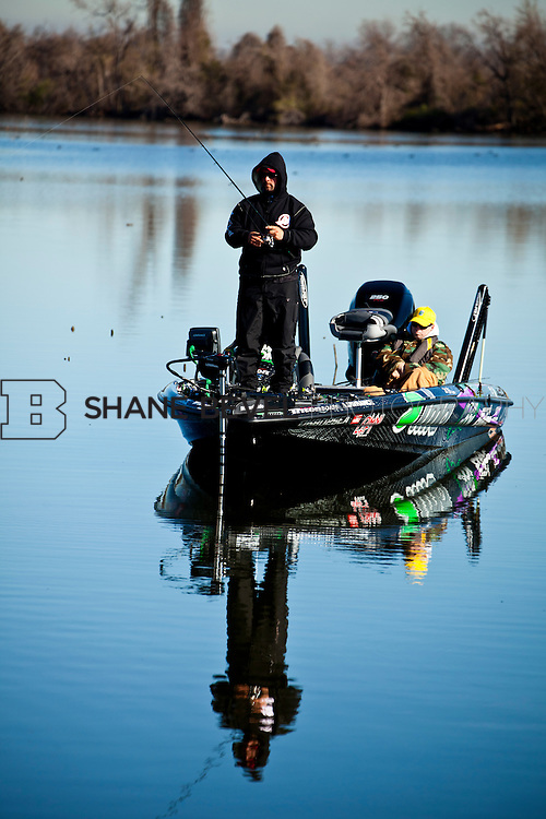2/25/12 10:22:55 AM -- during the 2012 Bassmaster Classic on the Red River in Shreveport, La. ..Photo by Shane BevelFred Roumbanis of Bixby, Okla. fishes on the Red River