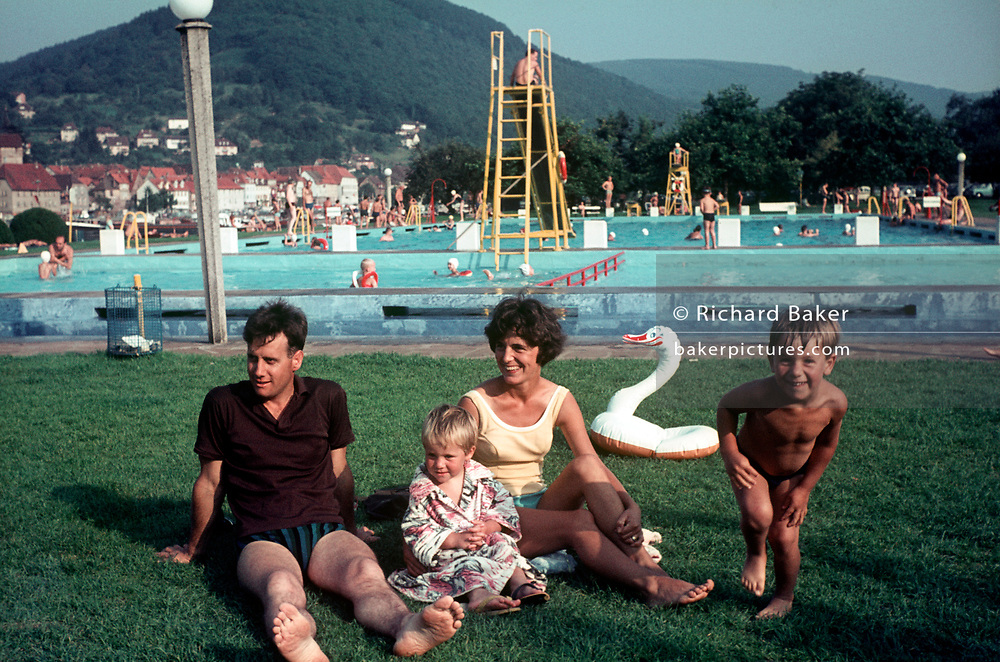 A sixties family holiday portrait at a German open-air pool, on 13th July, in North Rhine-Westphalia, Germany. (Photo by Richard Baker / In Pictures via Getty Images)