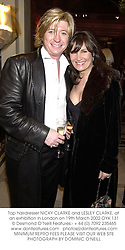 Top hairdresser NICKY CLARKE and LESLEY CLARKE, at an exhibition in London on 19th March 2002.	OYK 131