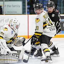 "TRENTON, ON  - MAY 2,  2017: Canadian Junior Hockey League, Central Canadian Jr. ""A"" Championship. The Dudley Hewitt Cup. Game 2 between Powassan Voodoos and Trenton Golden Hawks.  Dayton Murray #20 of the Powassan Voodoos and Ben Scheel #19 of the Trenton Golden Hawks battle in front of the net.<br /> (Photo by Amy Deroche / OJHL Images)"