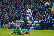 Gaetan Bong (Brighton) attempt at goal with Tom Cleverley (Watford) lying on the pitch during the Premier League match between Brighton and Hove Albion and Watford at the American Express Community Stadium, Brighton and Hove, England on 2 February 2019.