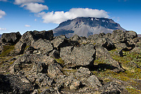 Lava and boulders by Herðubreiðarlindir, Highlands of North Iceland. Mount Herðubreið in background. Hraun og grjót við Herðubreiðarlindir. Herðubreið í baksýn.