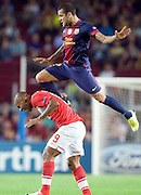 Dani Alves performs his own version of Kung-Fu football by kicking Ariclines Da Silva Ferreira Ari during the Group G UEFA Champions League match between FC Barcelona and Spartak Moscow at the Nou Camp, Barcelona, Spain 19th September 2012. Credit - Eoin Mundow/Cleva Media