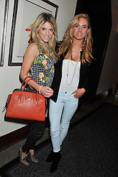 Left to right, OLIVIA COX and KIMBERLY GARNER at the launch of Whole World Water at The Savoy Hotel, London on 22nd March 2013.