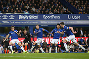 No way through for Chelsea midfielder Mason Mount (19) as Everton defender Leighton Baines (3) Everton midfielder Gylfi Sigurdsson (10) Everton defender Mason Holgate (2) and Everton defender Michael Keane (5) cover him off during the Premier League match between Everton and Chelsea at Goodison Park, Liverpool, England on 7 December 2019.
