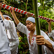 JULY 2, 2017 -  Men purify themselves by standing under water during Hirahara-no-Taki-biraki, an annual event at the Hirahara Waterfall in Nishio City, Japan. <br /> <br /> Each year, yaku-otoko, men whose current age is considered unlucky or risky, participate in this ceremony, known as mizugori. Water from the falls is directed through bamboo pipes and falls on the men, purifying and protecting them in their unlucky year. (Photo by Ben Weller/AFLO) (JAPAN) [UHU]