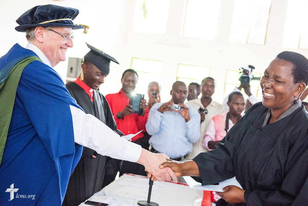 The Rev. Dr. Timothy Quill, professor and director of International Studies at Concordia Theological Seminary, Fort Wayne, Ind., shakes hands with Scholastica Bubembwas, a new deaconess, during the graduation of 21 pastors and seven deaconesses on Saturday, March 14, 2015, at the Evangelical Lutheran Church in Tanzania – South-East of Lake Victoria Diocese's (ELCT-SELVD) Ebenezer Cathedral in Shinyanga, Tanzania. LCMS Communications/Erik M. Lunsford