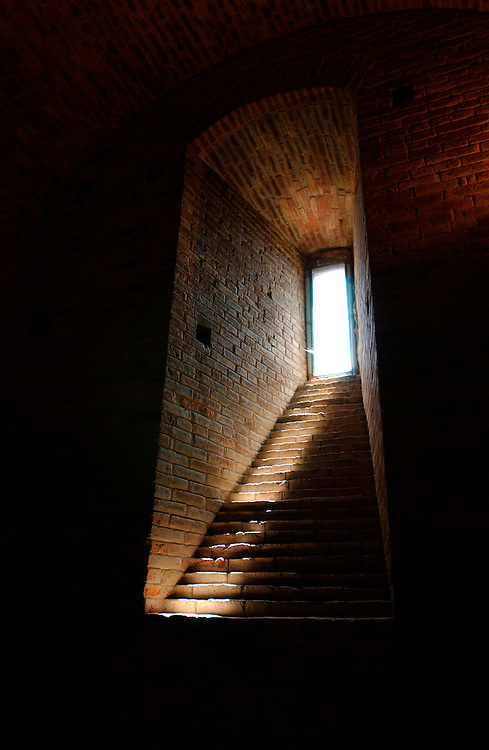 San Gimigiano Italy high window in brick wall of castle with streak of light.<br /> File name            .:DSC_0017.TIF. File size            .:16.9MB (17769094 bytes). Date and time        .:Mon, Aug 27, 2001 7:52:36 AM. Image size           .:3008 x 1960. Resolution           .:300 x 300 dpi. Number of bits       .:8 bits/channel. Protection           .:Off. Camera ID            .:N/A. Model name           .:NIKON D1X. Quality mode         .:HI (RGB Uncompress). Metering mode        .:Multi-pattern. Exposure mode        .:Aperture priority. Flash                .:Off. Focal length         .:17.0 mm. Shutter speed        .:1/125 seconds. Aperture             .:F2.8. Exposure compensation.:0.0 EV. Fixed white balance  .:Auto. Lens                 .:17-35 mm F2.8. Flash sync mode      .:N/A. Exposure difference  .:0.0 EV. Flexible program     .:No. Sensitivity          .:ISO250. Sharpening           .:Normal. Curve mode           .:Normal. Color mode           .:Color. Tone compensation    .:N/A. Latitude(GPS)        .:N/A. Longitude(GPS)       .:N/A. Altitude(GPS)        .:N/A