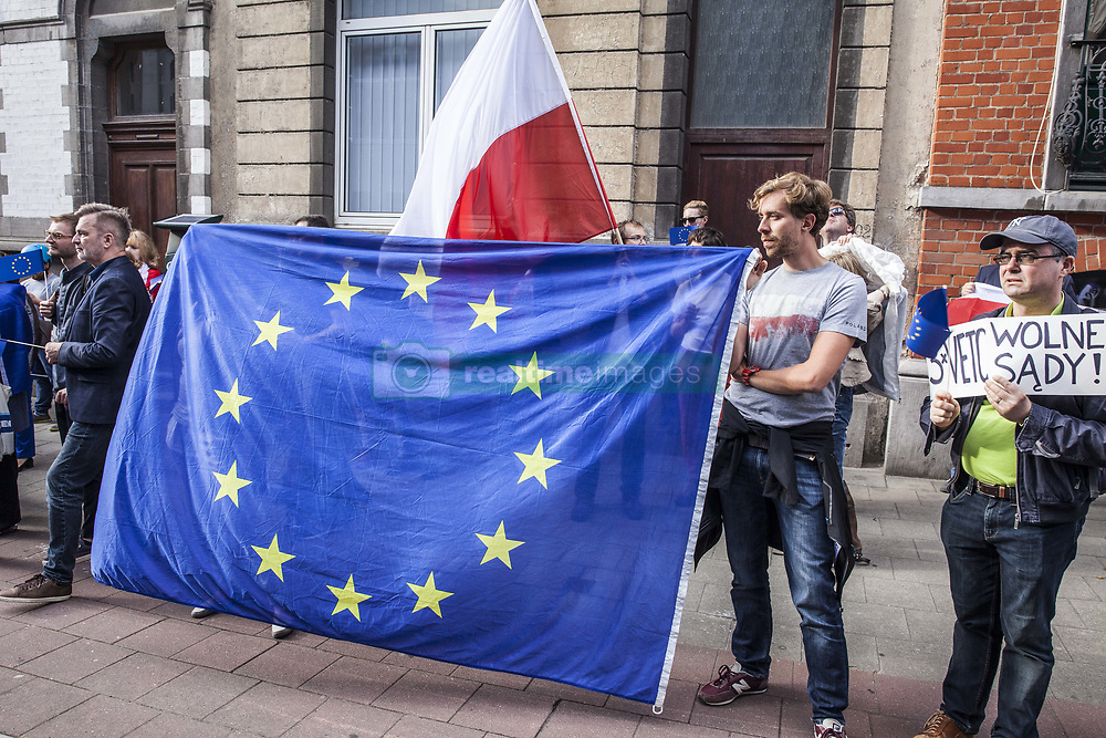 July 23, 2017 - Brussels, Belgium - Polish protesters stand in front of the Embassy of Poland in Brussels. The protest takes place to oppose the Polish court reforms on July 23, 2017 in Brussels. (Credit Image: © Kevin Van Den Panhuyzen/NurPhoto via ZUMA Press)
