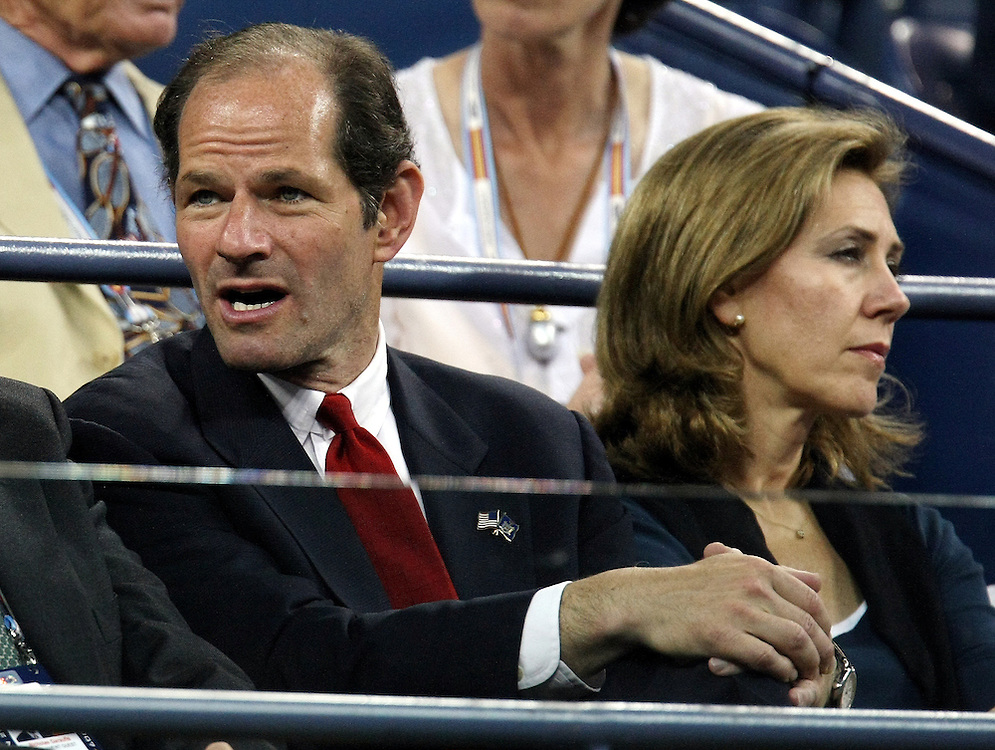 New York Governor Eliot Spitzer (L) and his wife Silda Wall Spitzer sit in the stands before the start of the Carlos Moya of Spain versus Novak Djokovic of Serbia quarterfinals round match on the eleventh day of the 2007 US Open tennis tournament in Flushing Meadows, New York, USA, 06 September 2007.