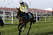 Pleasant Company and jockey Paul Townend head for the start of the 5:15pm The Randox Health Grand National Steeple Chase (Grade 3) 4m 2f during the Grand National Meeting at Aintree, Liverpool, United Kingdom on 6 April 2019.