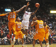 "Mississippi forward Terrance Henry (1) shoots between Tennessee's Scotty Hopson (32), Tennessee's Tobias Harris (12), Tennessee's John Fields (25), and Tennessee's Trae Golden (11) at the C.M. ""Tad"" Smith Coliseum in Oxford, Miss. on Satursday, January 29, 2011. Tennessee won 74-57. (AP Photo/Oxford Eagle, Bruce Newman)"