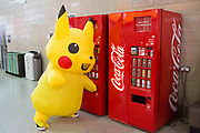 UNITED KINGDOM, London: 24 May 2019 <br /> A person dressed as Pikachu, a character from Japanese cartoon Pokémon, reaches in for a bottle from a vending machine at MCM London Comic Con. Thousands of cosplay enthusiasts will come to the ExCeL Centre across the next three days to enjoy the convention.