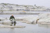 Person in foggy landscape.<br /> Kallsk&auml;r, Stockholm Archipelago, Sweden