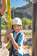 Big smile while zip lining in the Snake River Canyon with Zip the Snake in Twin Falls, Idaho. MR